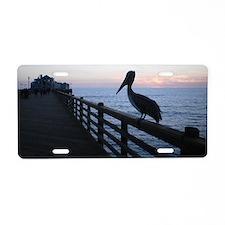 pelican at sunset Aluminum License Plate
