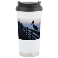 pelican at sunset Travel Mug