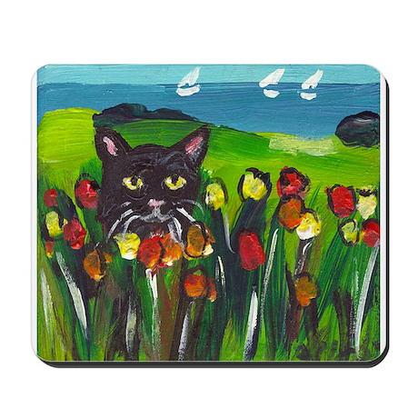 Black cat amongst tulips Mousepad