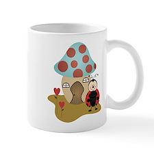ladybug with house Mugs