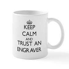 Keep Calm and Trust an Engraver Mugs