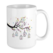 tree branch with birds and birdcages Mugs