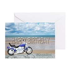 Birthday card with a motor bike on a beach. Greeti