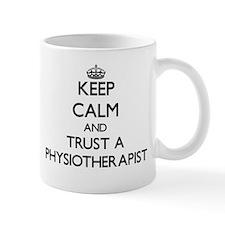 Keep Calm and Trust a Physioarapist Mugs