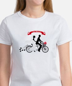 Just married bride and groom on tandem bicycle T-S