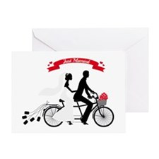 Just married bride and groom on tandem bicycle Gre