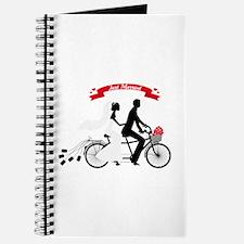 Just married bride and groom on tandem bicycle Jou