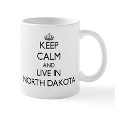 Keep Calm and Live In North Dakota Mugs