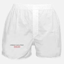 COMMUNITY DEVELOPMENT kicks a Boxer Shorts