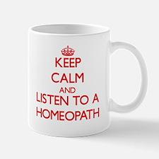 Keep Calm and Listen to a Homeopath Mugs