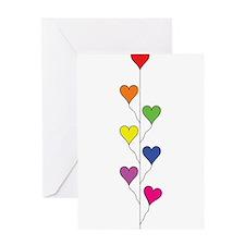 Seven Rainbow Colored Heart Balloons - Vertical Gr