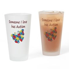 Someone I love has Autism (red) Drinking Glass
