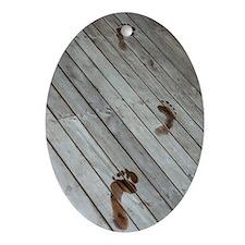 Wet footprints on a deck Oval Ornament