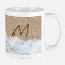 LETTERS IN SAND M Mugs