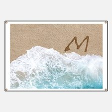 LETTERS IN SAND M Banner