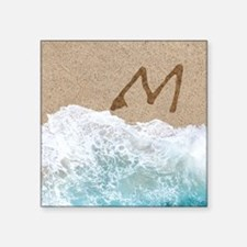 LETTERS IN SAND M Sticker