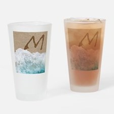 LETTERS IN SAND M Drinking Glass