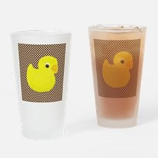Rubber Duck on Brown and White Drinking Glass