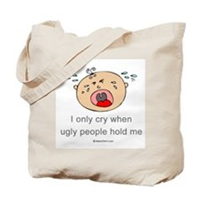 I only cry when ugly people hold me  Tote Bag