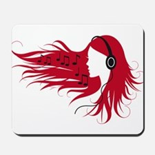 Music woman with headphones and red hair Mousepad