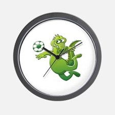 Brave alligator heading a soccer ball Wall Clock