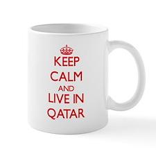 Keep Calm and live in Qatar Mugs