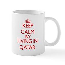 Keep Calm by living in Qatar Mugs