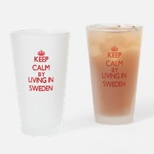 Keep Calm by living in Sweden Drinking Glass
