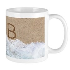 LETTERS IN SAND B Mugs