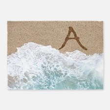 LETTERS IN SAND A 5'x7'Area Rug