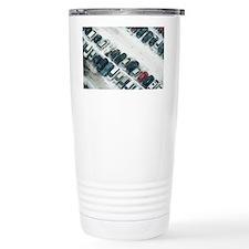 Cars in a parking lot u Travel Coffee Mug