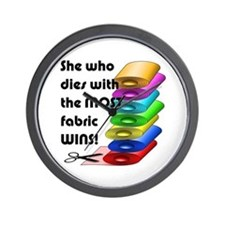 She who dies with the most fabric wins! Wall Clock