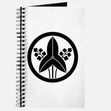 Standing arrowhead in circle Journal
