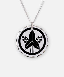 Standing arrowhead in circle Necklace