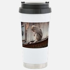 monkey on the roof Travel Mug