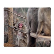 angry monkey Throw Blanket