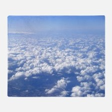 flight above the clouds Throw Blanket