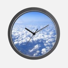 flight above the clouds Wall Clock
