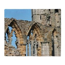 Graceful arches in Whitby Abbey ruin Throw Blanket