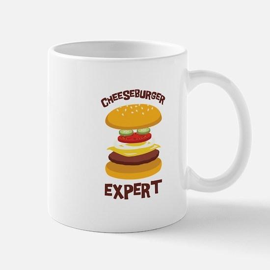 CHEESEBURGER EXPERT Mugs