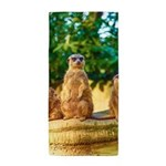 Meerkats standing guard Beach Towel