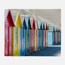 Row of beach huts at Whitby Sands Throw Blanket