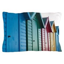 Brightly coloured wooden beach huts Pillow Case