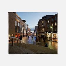 Buchanan Street in central Glasgow Throw Blanket