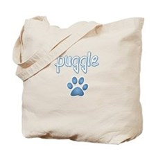 word Puggle with a paw print Tote Bag