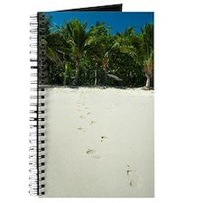 Footprints on a tropical beach Journal