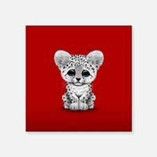 Cute Baby Snow Leopard Cub on Red Sticker