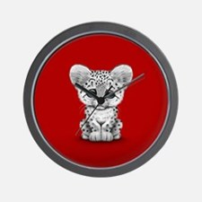 Cute Baby Snow Leopard Cub on Red Wall Clock