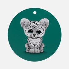 Cute Baby Snow Leopard Cub on Teal Blue Ornament (