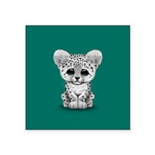 Cute Baby Snow Leopard Cub on Teal Blue Sticker